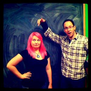 Jeff pointing to Tara's pink hair in excitement